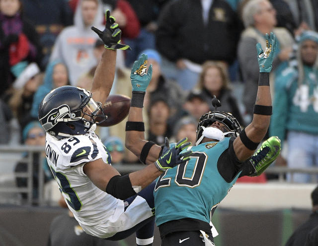 <p>Jacksonville Jaguars cornerback Jalen Ramsey, right, breaks up a pass intended for Seattle Seahawks wide receiver Doug Baldwin, left, during the first half of an NFL football game, Sunday, Dec. 10, 2017, in Jacksonville, Fla. (AP Photo/Phelan M. Ebenhack) </p>