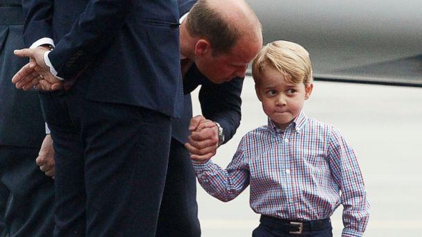 PHOTO: Britain's Prince William, left, holds the hand of his son Prince George on arrival at the airport, in Warsaw, Poland, July 17, 2017. (Czarek Sokolowski/AP, FILE)