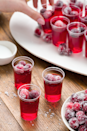 "<p>If you're feeling extra fancy, you can top these basic Jell-O shots with your own homemade sugared cranberries. </p><p><a href=""https://www.delish.com/cooking/recipe-ideas/recipes/a44613/cranberry-jello-shots/"" rel=""nofollow noopener"" target=""_blank"" data-ylk=""slk:Get the recipe from Delish »"" class=""link rapid-noclick-resp""><em>Get the recipe from Delish »</em></a></p>"