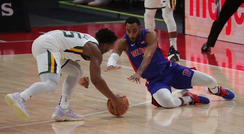 Pistons guard Wayne Ellington defends against Jazz guard Donovan Mitchell during the first period at Little Caesars Arena on Sunday, Jan. 10, 2021.