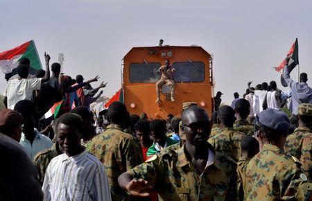 Sudanese military and demonstrators attending a sit-in block a train from passing through, during a protest outside the Defence Ministry in Khartoum, Sudan April 14, 2019. REUTERS/Stringer