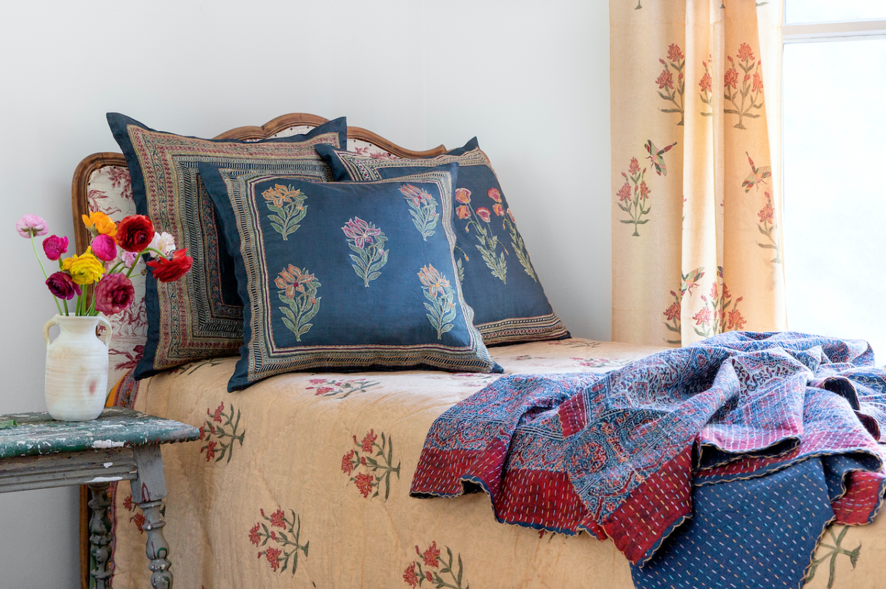 """<p><a href=""""https://marigoldliving.com/"""" target=""""_blank"""">Marigold Living</a> may have launched just over a year ago, but the techniques behind its exquisite hand-crafted Indian designs are age-old. The result: An assortment of bright silk and cotton textiles splashed with heritage prints that's unlike any other. Naturally, the labor of love immediately caught the eye of Lauren Santo Domingo, co-founder of the online fashion and home retailer <a href=""""https://www.modaoperandi.com/women"""" target=""""_blank"""">Moda Operandi</a>. And when that arbiter of all things en-vogue inevitably approached the brand for its first-ever collaboration, they cheerfully obliged. It's the marriage of two companies both dedicated to impeccable design, so the match made perfect sense.<br><br>Now Marigold has officially joined the ranks of Moda's star brands, and we couldn't be more excited to shop its newly launched <a href=""""https://www.modaoperandi.com/marigold-living/home"""" target=""""_blank"""">Botanical Collection</a> of throw pillows. Each one is fashioned from Tussar silk that's been dipped into the richest indigo dye and then adorned with hand-embroidered flowers by a team of artisans in India. For the print-obsessed, these beautiful, lovingly crafted pillows are a no-brainer—switch out your old throw pillows now for a perfect summer-entertaining tableau.</p>"""