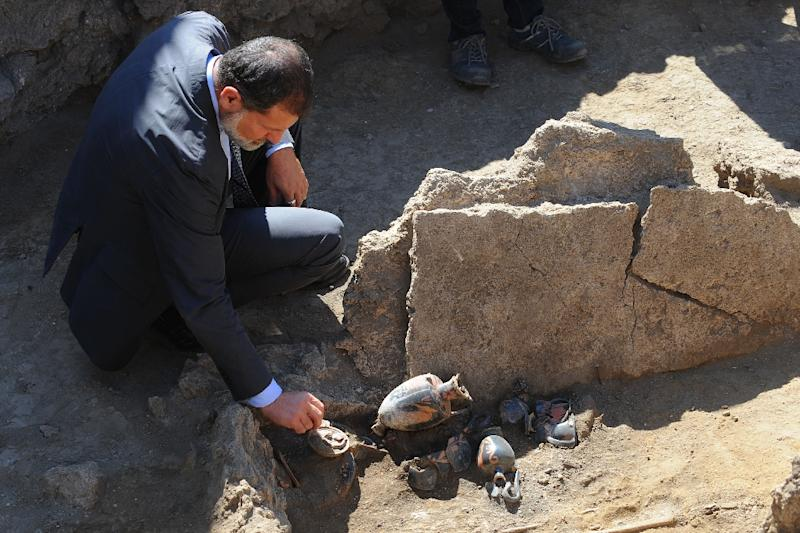 Massimo Osanna, superintendent of Pompeii ruins, shows a Samnite tomb of the fourth century BC with a woman's skeleton and many amphoras discovered inside ancient ruins of Pompeii on September 21, 2015