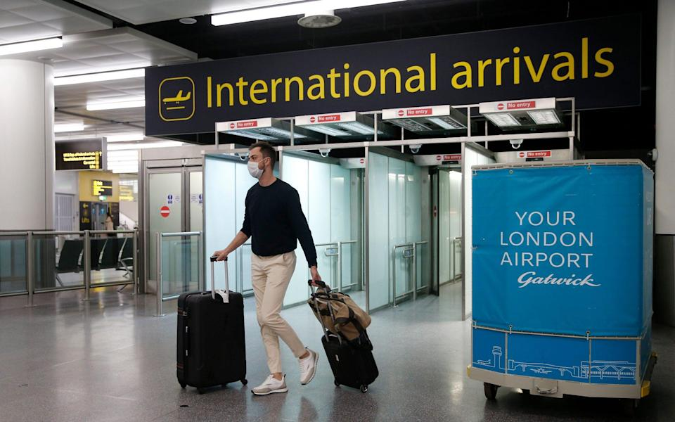 A traveler arrives at the North Terminal at Gatwick Airport - Hollie Adams/Getty Images Europe
