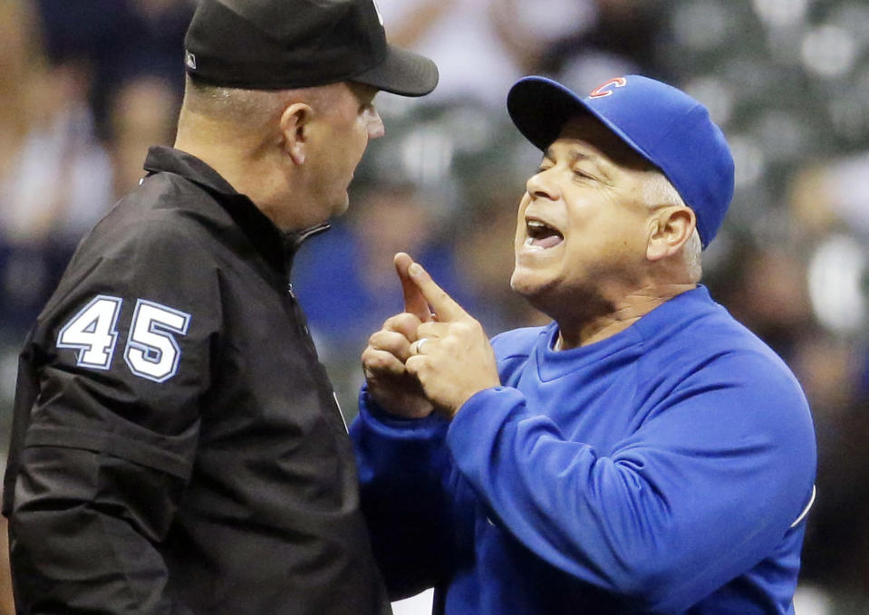 FILE - In this Sept. 26, 2014, file photo, Chicago Cubs manager Rick Renteria, right, argues with umpire Jeff Nelson during the eighth inning of a baseball game against the Milwaukee Brewers, in Milwaukee. The Cubs have fired Renteria after one season to pursue former Tampa Bay manager Joe Maddon. Team President Theo Epstein said Friday, Oct. 31, 2014, that Renteria deserved to come back next season as the Cubs continue their rebuilding effort. But Maddon opted out of his contract with the Rays and Epstein says that changed things for the Cubs. (AP Photo/Morry Gash, File)