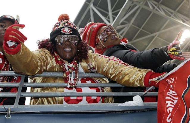 San Francisco 49ers fans wait for players to come out to warm up before the NFL football NFC Championship game against the Seattle Seahawks Sunday, Jan. 19, 2014, in Seattle. (AP Photo/Ted S. Warren)
