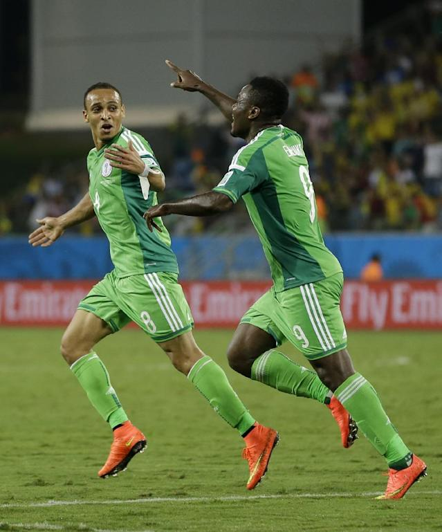 Nigeria's Peter Odemwingie, left, celebrates with Emmanuel Emenike after scoring his side's opening goal during the group F World Cup soccer match between Nigeria and Bosnia at the Arena Pantanal in Cuiaba, Brazil, Saturday, June 21, 2014. (AP Photo/Kirsty Wigglesworth)