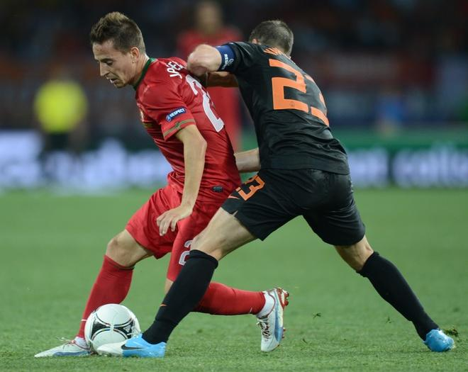 Portuguese defender Joao Pereira (L) vies with Dutch midfielder Rafael van der Vaart during the Euro 2012 football championships match Portugal vs. Netherlands, on June 17, 2012 at the Metalist stadium in Kharkiv. AFP PHOTO / FRANCISCO LEONGFRANCISCO LEONG/AFP/GettyImages