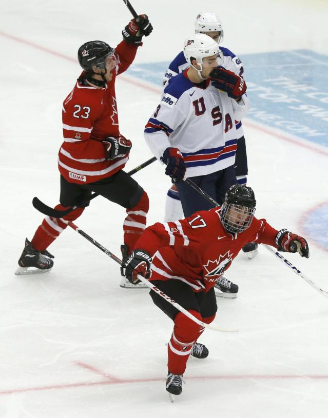 Canada's Connor McDavid (17) celebrates his goal with teammate Sam Reinhart (23) in front of United States' Ian McCoshen (3) during the third period of their IIHF World Junior Championship ice hockey game in Malmo, Sweden, December 31, 2013. REUTERS/Alexander Demianchuk (SWEDEN - Tags: SPORT ICE HOCKEY)