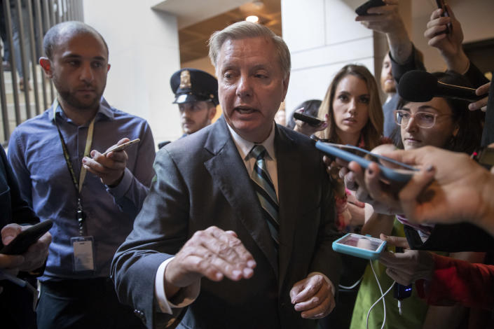 Sen. Lindsey Graham speaks outside a secure underground room in the Capitol where senators were briefed on the FBI background file on sexual allegations made against Kavanaugh, on Oct. 3, 2018. (Photo: J. Scott Applewhite/AP)