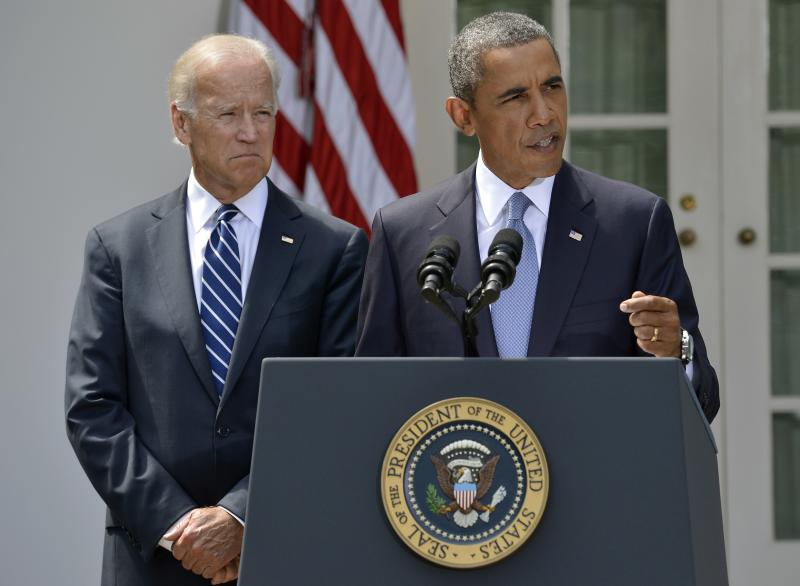 U.S. President Barack Obama speaks next to Vice President Joe Biden (L) at the Rose Garden of the White House August 31, 2013, in Washington. Obama said on Saturday he had decided the United States should strike Syrian government targets in response to a deadly chemical weapons attack, but said he would seek a congressional vote for any military action. REUTERS/Mike Theiler (UNITED STATES - Tags: POLITICS TPX IMAGES OF THE DAY)