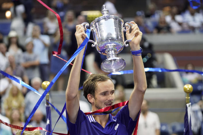 Daniil Medvedev, of Russia, holds up the championship trophy after defeating Novak Djokovic, of Serbia, in the men's singles final of the US Open tennis championships, Sunday, Sept. 12, 2021, in New York. (AP Photo/John Minchillo)
