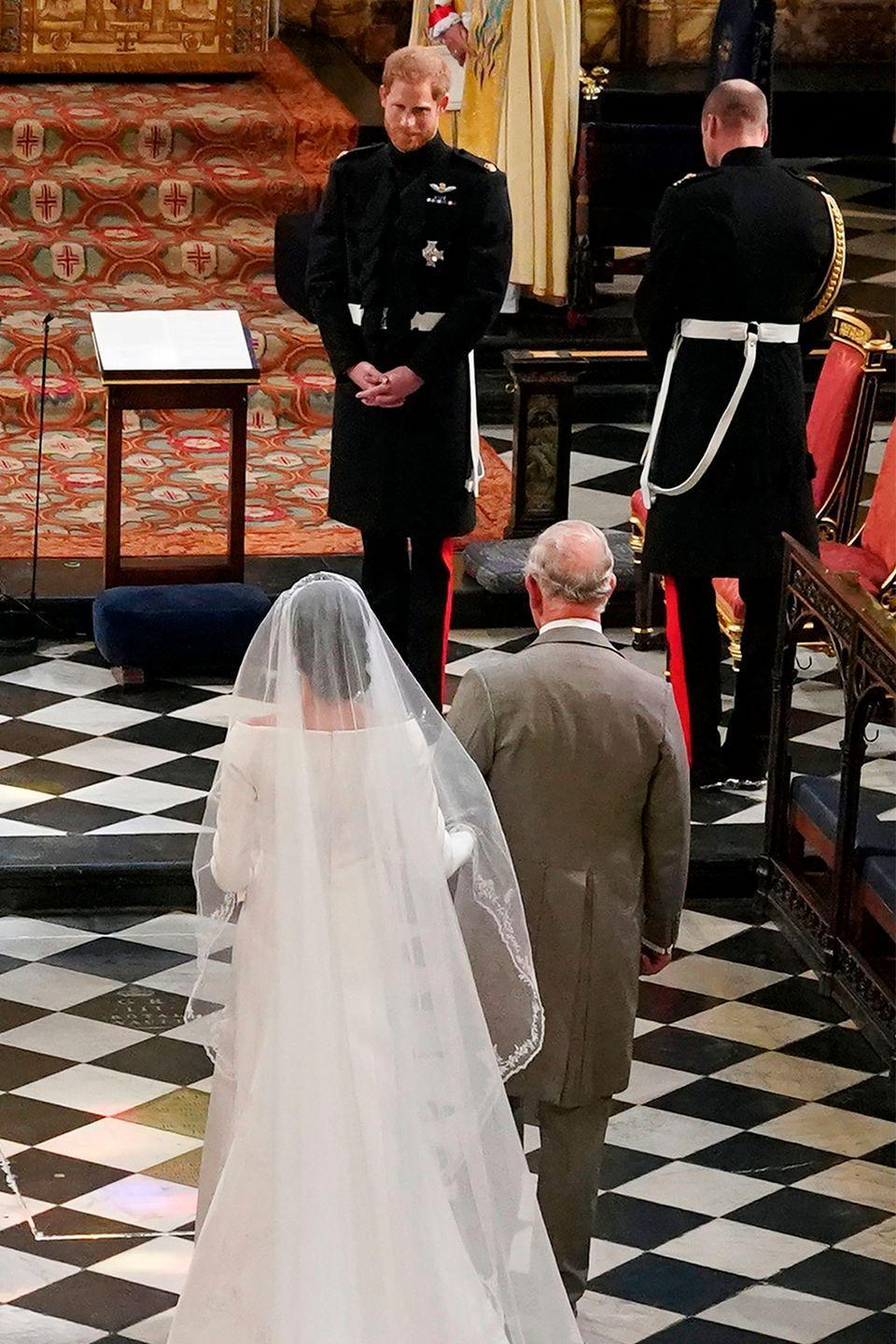 """<p>In a major tradition-breaking moment, <a href=""""https://www.marieclaire.com/celebrity/a20740766/prince-charles-walking-meghan-markle-down-aisle/"""" rel=""""nofollow noopener"""" target=""""_blank"""" data-ylk=""""slk:Prince Charles walked Meghan down the aisle"""" class=""""link rapid-noclick-resp"""">Prince Charles walked Meghan down the aisle</a> for her May 2018 wedding to Prince Harry. The decision was made by Her Majesty after Meghan's father, <a href=""""https://www.marieclaire.com/celebrity/a22159695/thomas-markle-meghan-markle-terrified-interview/"""" rel=""""nofollow noopener"""" target=""""_blank"""" data-ylk=""""slk:Thomas Markle"""" class=""""link rapid-noclick-resp"""">Thomas Markle</a>, backed out of the ceremony. </p>"""