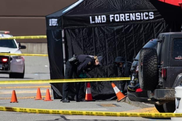 RCMP forensic officers are pictured at the scene of a fatal shooting outside of the Langley Sportplex in Langley, British Columbia on Wednesday, April 21, 2021. (Ben Nelms/CBC - image credit)