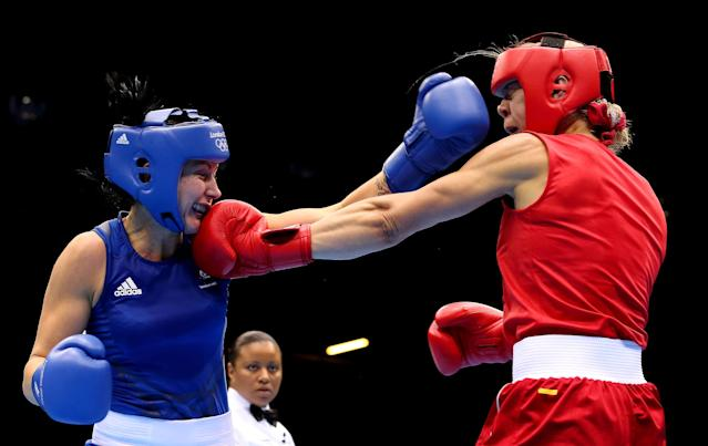 LONDON, ENGLAND - AUGUST 05: Anna Laurell of Sweden (R) in action with Naomi-Lee Fischer-Rasmussen of Australia during the Women's Middle (69-75kg) Boxing on Day 9 of the London 2012 Olympic Games at ExCeL on August 5, 2012 in London, England. (Photo by Scott Heavey/Getty Images)