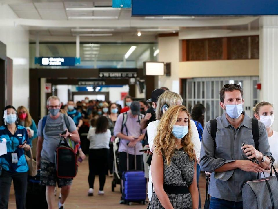 Visitors at the Daniel K. Inouye International Airport in Honolulu, Hawaii, enter the state after the new pre-travel testing program launched.