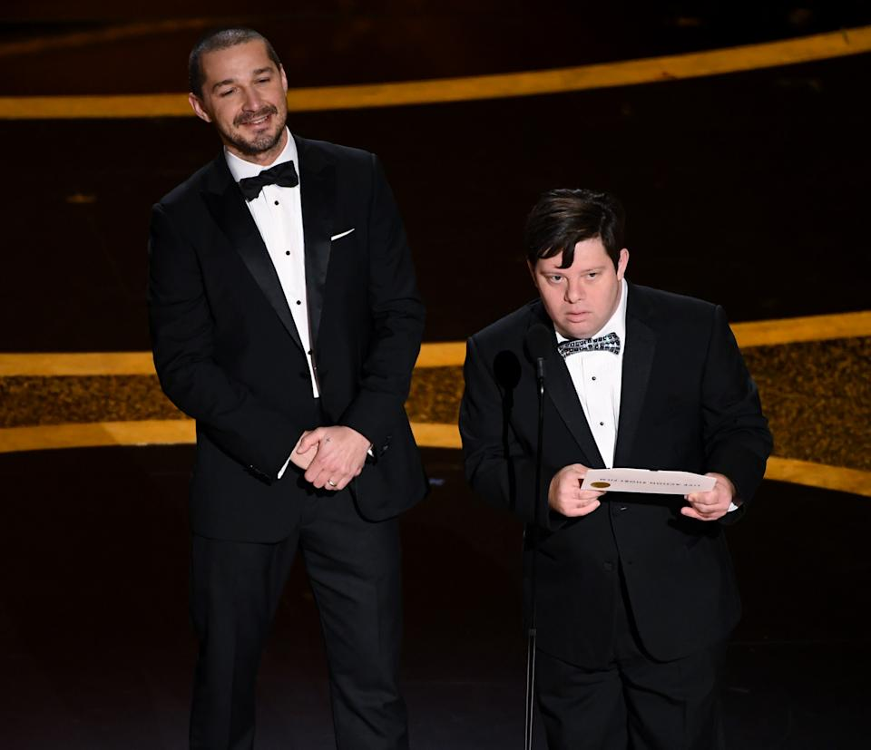 HOLLYWOOD, CALIFORNIA - FEBRUARY 09: (L-R) Shia LaBeouf and Zack Gottsagen speak onstage during the 92nd Annual Academy Awards at Dolby Theatre on February 09, 2020 in Hollywood, California. (Photo by Kevin Winter/Getty Images)