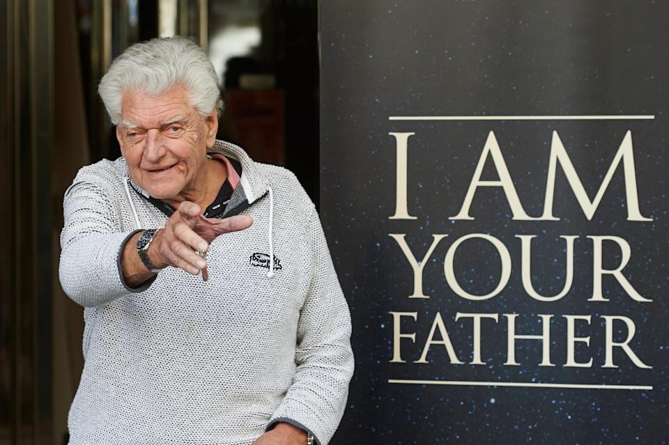 "David Prowse (seen here in 2015 at a photo call for the documentary ""I Am Your Father), who famously played Darth Vader in the original ""Star Wars"" trilogy, has died at 85."