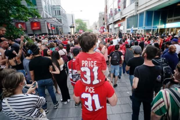 A Carey Price fan, upon another Carey Price fan, were among those outside the Bell Centre Thursday, where the Habs beat the Vegas Golden Knights. (Ivanoh Demers/Radio-Canada - image credit)