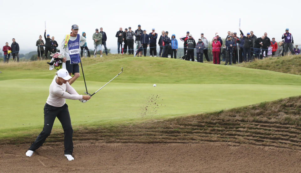 Sweden's Anna Nordqvist plays out of a bunker on the 14th green during the third round of the Women's British Open golf championship, in Carnoustie, Scotland, Saturday, Aug. 21, 2021. (AP Photo/Scott Heppell)
