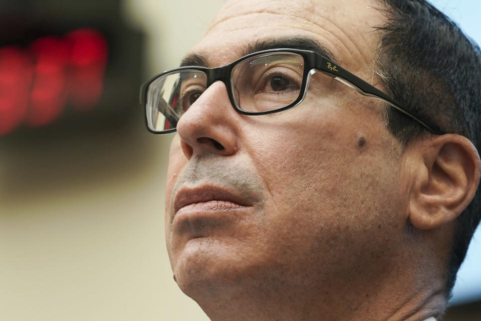 Treasury Secretary Steven Mnuchin answers questions during a House Financial Services Committee hearing on Capitol Hill in Washington, Wednesday, Dec. 2, 2020. (Greg Nash/Pool via AP)