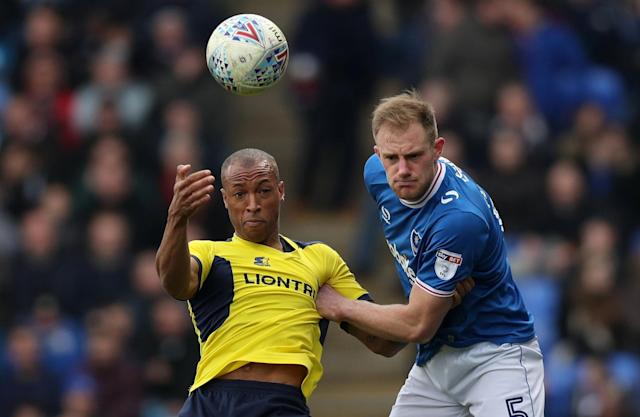"Soccer Football - League One - Portsmouth vs Oxford United - Fratton Park, Portsmouth, Britain - March 25, 2018 Portsmouth's Matt Clarke in action with Oxford United's Wes Thomas Action Images/Peter Cziborra EDITORIAL USE ONLY. No use with unauthorized audio, video, data, fixture lists, club/league logos or ""live"" services. Online in-match use limited to 75 images, no video emulation. No use in betting, games or single club/league/player publications. Please contact your account representative for further details."