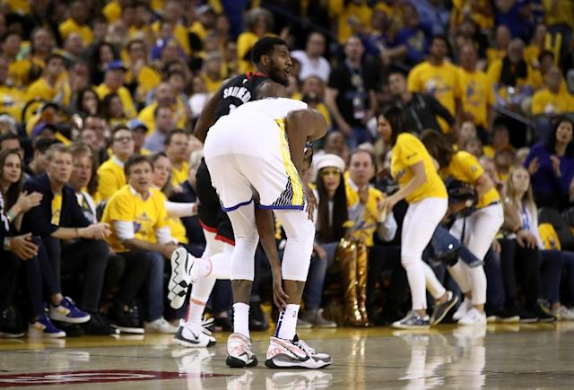 Kevin Durant of the Golden State Warriors grabs his right leg after injuring himself against the Houston Rockets during game five of their best of seven series (AFP Photo/EZRA SHAW)