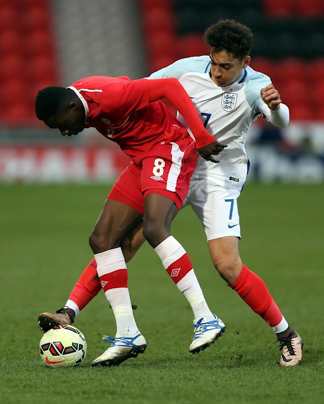 DONCASTER, ENGLAND - MARCH 27: Tyler Walker of England (R) challenges Alphonso Davies of Canada during the U20 International Friendly match between England and Canada at the Keepmoat Stadium on March 27, 2016 in Doncaster, England. (Photo by Nigel Roddis/Getty Images)