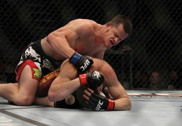 LAS VEGAS, NV - MAY 26:  CB Dollaway (top) punches Jason Miller during a middleweight bout at UFC 146 at MGM Grand Garden Arena on May 26, 2012 in Las Vegas, Nevada.