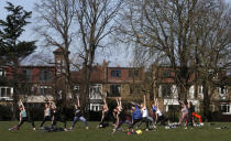 FILE - In this Monday, March 29, 2021 file photo, a group of women exercise in a park in London, following the easing of England's coronavirus lockdown to allow greater freedom outdoors. Thanks to an efficient vaccine roll out program and high uptake rates, Britain is finally saying goodbye to months of tough lockdown restrictions. From Monday May 17, 2021, all restaurants and bars can fully reopen, as can hotels, cinemas, theatres and museums, and for the first time since March 2020, Britons can hug friends and family and meet up inside other people's houses. (AP Photo/Frank Augstein, File)