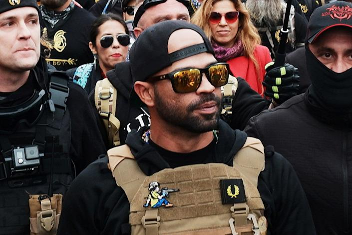 <p>Proud Boys leader Enrique Tarrio, pictured on 12 December, was arrested in Washington DC on 4 January on destruction of property charges. He also was in possession of two high-capacity firearm magazines, unloaded.</p> (EPA)