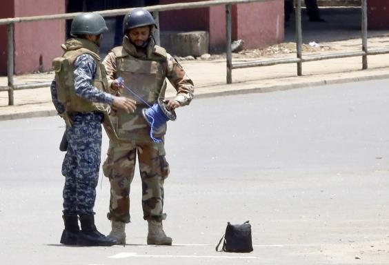 Special forces prepare to defuse a suspected bomb in Colombo on Wednesday (EPA)
