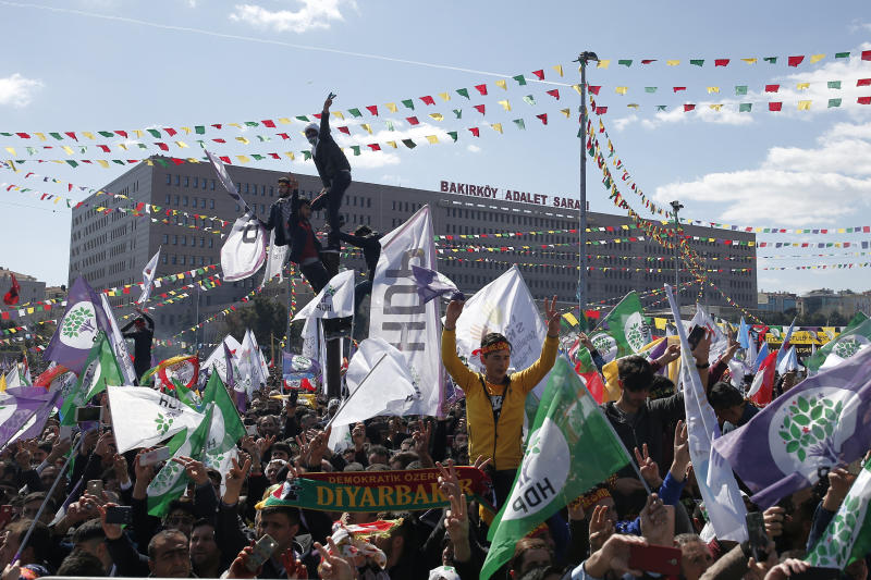 Thousands of supporters of pro-Kurdish Peoples' Democratic Party, or HDP, gather to celebrate the Kurdish New Year and to attend a campaign rally for local elections that will test the Turkish president's popularity, in Istanbul, Sunday, March 24, 2019. The HDP held the event amid the municipal office races that have become polarizing and a government crackdown on its members for alleged links to outlawed Kurdish militants. (AP Photo/Emrah Gurel)