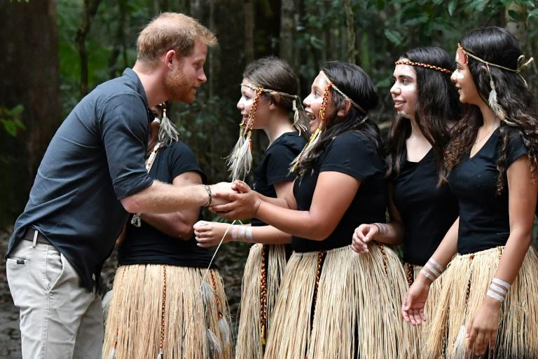 Britain's Prince Harry talked to members of the Butchulla people, who are the traditional owners of Fraser Island, during his visit