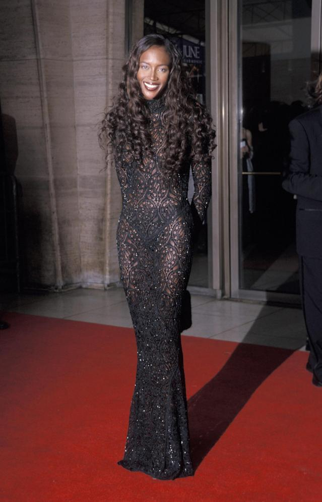 This 1999 look isn't a million miles away from her Fashion For Relief London 2019 style a mere 20 years later. This fitted, sheer gown was made for Campbell's stunning wavy hair. [Getty Images]