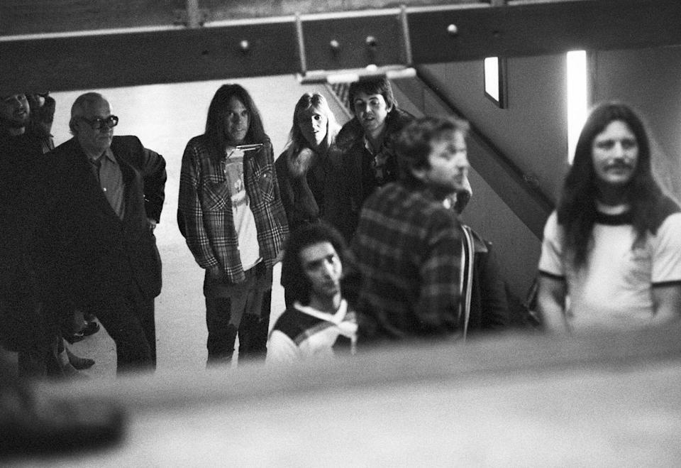 <p>Neil Young (3rd from left) and Frank Sampedro and Ralph Molina of Crazy Horse stand backstage with Paul McCartney and Linda McCartney at the Kuip stadium in Rotterdam, Netherlands in 1976. </p>