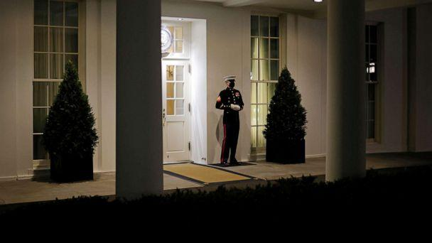 PHOTO: A U.S. Marine is seen posted at the West Wing door, an indication that President Donald Trump is in the Oval Office, after his supporters stormed the U.S. Capitol, in Washington, Jan. 6, 2021. (Carlos Barria/Reuters)