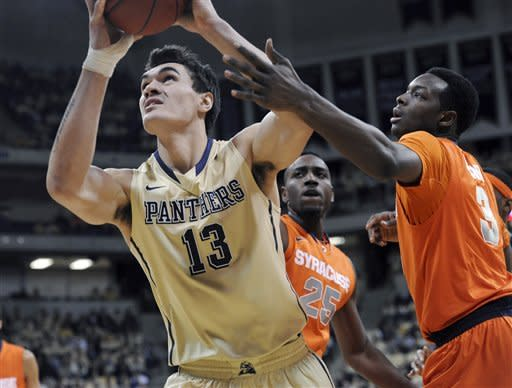 Pittsburgh's Steven Adams drives past Syracuse Jerami Grant, right, during the first half of an NCAA college basketball game in Pittsburgh, Saturday, Feb. 2, 2013. (AP Photo/John Heller)