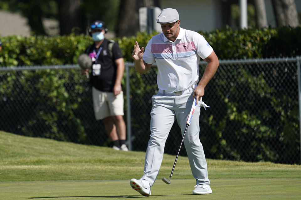Bryson DeChambeau waves after a birdie putt on the 15th hole during the second round of the Charles Schwab Challenge golf tournament at the Colonial Country Club in Fort Worth, Texas, Friday, June 12, 2020. (AP Photo/David J. Phillip)