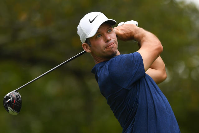 Paul Casey, of England, hits out of the fifth teebox during the final round of the Tour Championship golf tournament Sunday, Aug. 25, 2019, in Atlanta. (AP Photo/John Amis)