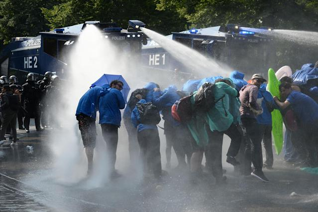 <p>Police uses a water canon while demonstrators block a street during protests against the G-20 summit in Hamburg, Germany, Friday, July 7, 2017. (Photo: Daniel Reinhardt/dpa via AP) </p>
