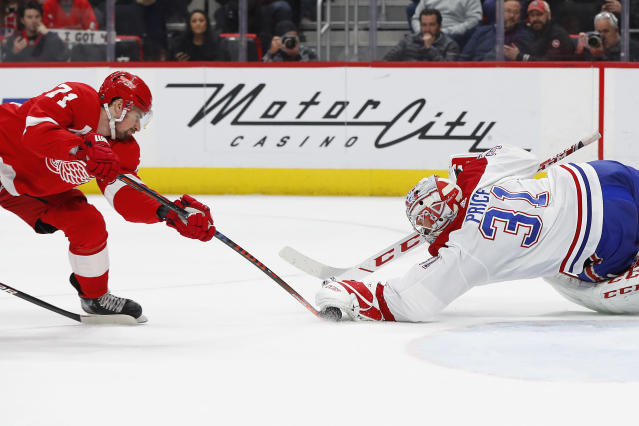 Montreal Canadiens goaltender Carey Price (31) stops a Detroit Red Wings center Dylan Larkin (71) shot in the second period of an NHL hockey game, Tuesday, Feb. 26, 2019, in Detroit. (AP Photo/Paul Sancya)