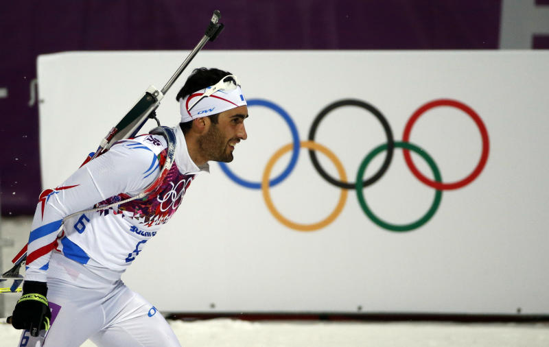France's Martin Fourcade competes on his way to win the gold medal in the men's biathlon 12.5k pursuit, at the 2014 Winter Olympics, Monday, Feb. 10, 2014, in Krasnaya Polyana, Russia. (AP Photo/Felipe Dana)