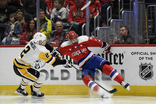 Washington Capitals defenseman Michal Kempny (6) loses his balance next to Pittsburgh Penguins defenseman Chad Ruhwedel (2) during the second period of an NHL hockey game, Sunday, Feb. 23, 2020, in Washington. (AP Photo/Nick Wass)