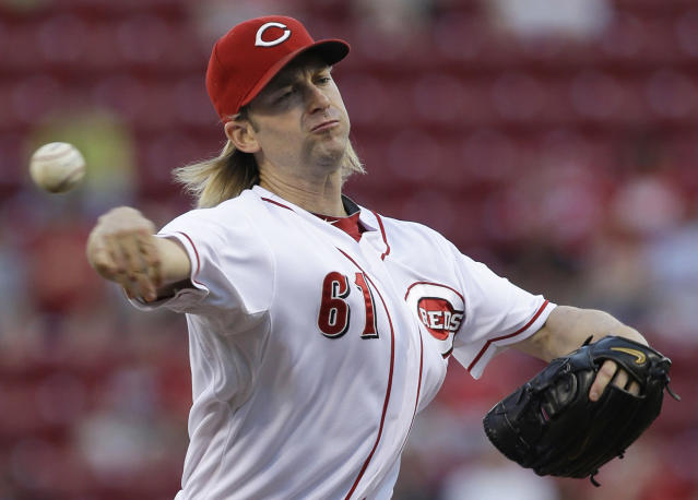 Cincinnati Reds starting pitcher Bronson Arroyo throws to a St. Louis Cardinals batter in the first inning of a baseball game, Wednesday, Sept. 4, 2013, in Cincinnati. (AP Photo/Al Behrman)