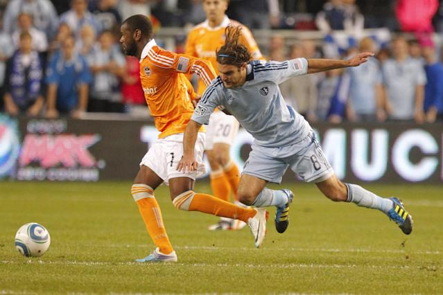 KANSAS CITY, KS - NOVEMBER 06: Graham Zusi #08 of the Sporting Kansas City trips while defending Luiz Camargo #17 of the Houston Dynamo in the second half during the MLS Eastern Conference Championship match at Livestrong Sporting Park on November 06, 2011 in Kansas City, Kansas. (Photo by Kyle Rivas/Getty Images)