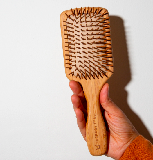 "<p><strong>Package Free</strong></p><p>packagefreeshop.com</p><p><strong>$20.00</strong></p><p><a href=""https://packagefreeshop.com/products/package-free-bamboo-hairbrush?variant=30976884146273&gclid=EAIaIQobChMIpp_78vPh6gIVwAiICR0OeA9BEAQYASABEgLu9PD_BwE"" rel=""nofollow noopener"" target=""_blank"" data-ylk=""slk:SHOP IT"" class=""link rapid-noclick-resp"">SHOP IT</a></p><p>Junky plastic hairbrushes seem so...junior high? This wooden one is much more grown-up and doesn't beg to be hidden.</p>"