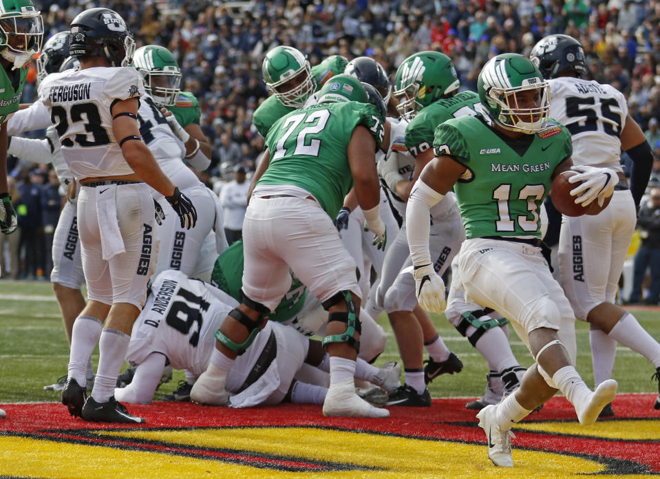 North Texas running back DeAndre Torrey (13) scores a touchdown against Utah State during the first half of the New Mexico Bowl NCAA college football game in Albuquerque, N.M., Saturday, Dec. 15, 2018. (AP Photo/Andres Leighton)