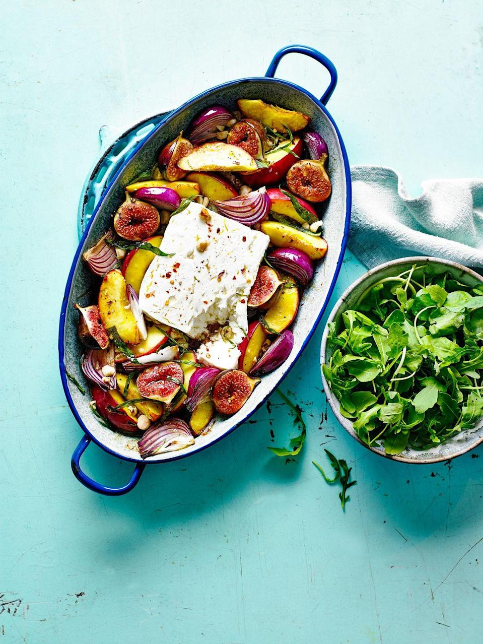 """<p>This fruity feta traybake is ready in 30 minutes which makes an ideal summery midweek meal.</p><p><strong>Recipe: <a href=""""https://www.goodhousekeeping.com/uk/food/recipes/a29206664/baked-feta-traybake/"""" rel=""""nofollow noopener"""" target=""""_blank"""" data-ylk=""""slk:Fruity Baked Feta Traybake"""" class=""""link rapid-noclick-resp"""">Fruity Baked Feta Traybake</a></strong></p>"""