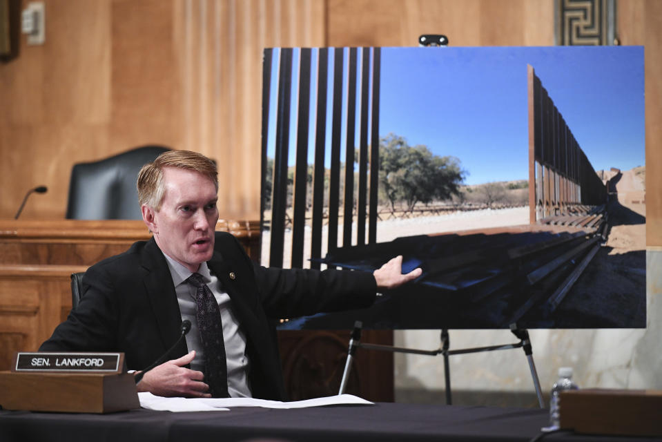 """FILE - In this Thursday, May 13, 2021 file photo, Sen. James Lankford, R-Okla., points to a photograph of a border fence section during a Senate Homeland Security and Governmental Affairs Committee on unaccompanied minors at the southern border, on Capitol Hill in Washington. Black community members in his constituency criticize Oklahoma Republicans' support for national GOP efforts to limit voting opportunities, and especially Lankford's plan to challenge the certification of the 2020 presidential election over ballots cast in cities with large black populations. Lankford later issued an apology to Black Tulsans. """"I can assure you, my intent to give a voice to Oklahomans who had questions was never also an intent to diminish the voice of any Black American,"""" he said. (Mandel Ngan/Pool via AP, File)"""